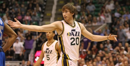 Rick Egan  | The Salt Lake Tribune   Utah Jazz small forward Gordon Hayward (20) reacts after being poked in the head by Dallas Mavericks shooting guard Delonte West (13) after the play, in NBA action, The Utah Jazz, vs. Dallas Mavericks, at  EnergySolutions Arena, Monday, April 16, 2012.
