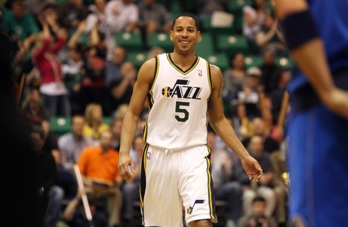 Rick Egan  | The Salt Lake Tribune   Utah Jazz point guard Devin Harris (5) smiles after hitting a 3-pointer giving the Jazz a four point lead in the first quarter,  in NBA action,  the Dallas Mavericks vs. The Utah Jazz, at  EnergySolutions Arena, Monday, April 16, 2012.