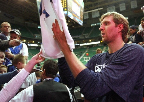 Rick Egan  | The Salt Lake Tribune   Dallas Maverick's Dirk Nowitzki signs autographs before the game agains the Dallas Mavericks, at he EnergySolutions Arena, Monday, April 16, 2012.