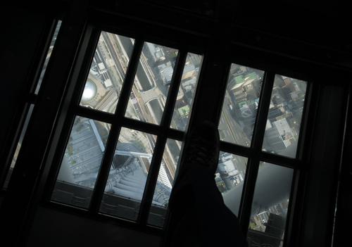 The ground view is seen through the glass floor of the 450-meter (1,476 feet)-high observation deck of the Tokyo Sky Tree during a press preview in Tokyo Tuesday, April 17, 2012. The world's tallest freestanding broadcast structure that stands 634-meter (2,080 feet) will open to the public in May. (AP Photo/Itsuo Inouye)
