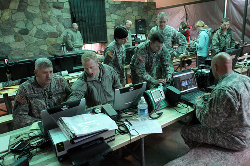 Francisco Kjolseth  |  The Salt Lake Tribune The National Guard's 19th Special Forces Group sets up a comunications hub at Sugarhouse Park on Tuesday, April 17, 2012, as part of the Utah Shake Out earthquake drill.