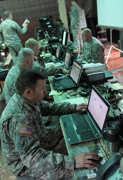 Francisco Kjolseth  |  The Salt Lake Tribune Master Sargeant Mike Dunston, foreground, of The National Guard's 19th Special Forces Group sets up a comunications hub at Sugarhouse Park on Tuesday, April 17, 2012, as part of the Utah Shake Out earthquake drill.