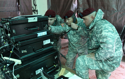 Francisco Kjolseth  |  The Salt Lake Tribune Sargeant 1st Class Eric Hutsman, center, works with specialists Tyler Anderson, left, and Paul Saupan to set up a radio base station as back up as the team of the National Guard's 19th Special Forces Group sets up a comunications hub at Sugarhouse Park on Tuesday, April 17, 2012, as part of the Utah Shake Out earthquake drill.