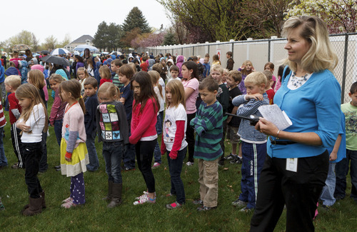 Trent Nelson  |  The Salt Lake Tribune Teacher Victoria DiPietro with her first grade class after evacuating Granite Elementary during a statewide earthquake drill Tuesday, April 17, 2012 in Sandy, Utah.