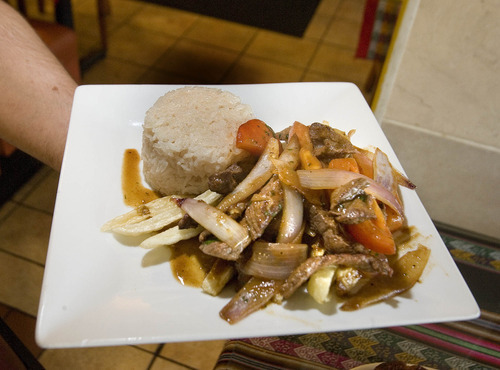 Paul Fraughton | The Salt Lake Tribune The Lomo Saltado (sauted beef with onions tomatoes over french fries served with rice) at El Rocoto, a Peruvian restaurant  in West Valley City.