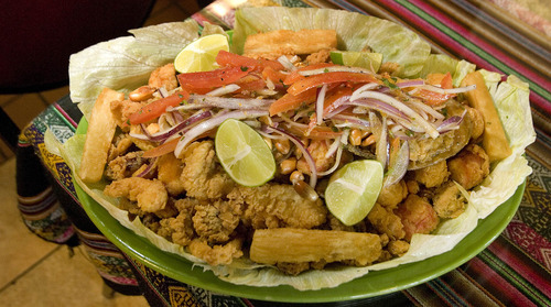Paul Fraughton | The Salt Lake Tribune An entree of deep-fried seafood  with onions, salsa and yucca, served at El Rocoto in West Valley City.