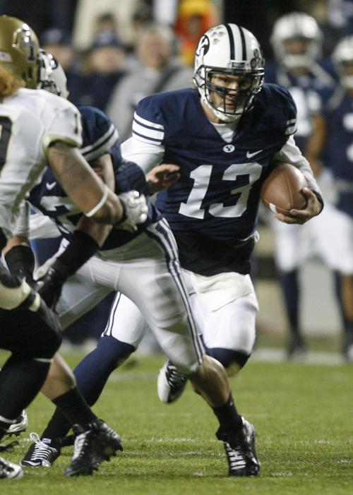Rick Egan  | The Salt Lake Tribune   Brigham Young Cougars quarterback Riley Nelson runs the ball against the  Idaho Vandals at Lavell Edwards Stadium, Saturday, Nov. 12, 2011.