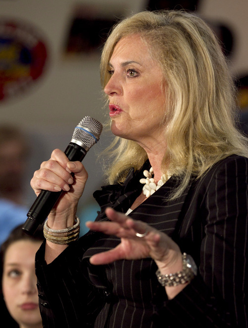 In this March 19, 2012, file photo, Ann Romney, wife of Republican presidential candidate, former Massachusetts Gov. Mitt Romney, speaks during a campaign stop at a restaurant in Springfield, Ill. The spotlight on Ann Romney is getting brighter. (AP Photo/Steven Senne, File)