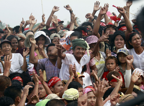 Supporters of Myanmar pro-democracy leader Aung San Suu Kyi enjoy singers' performance during her visit to Kawhmu township in Yangon, Myanmar, on New Year's Day, Tuesday, April 17, 2012. (AP Photo/Khin Maung Win)