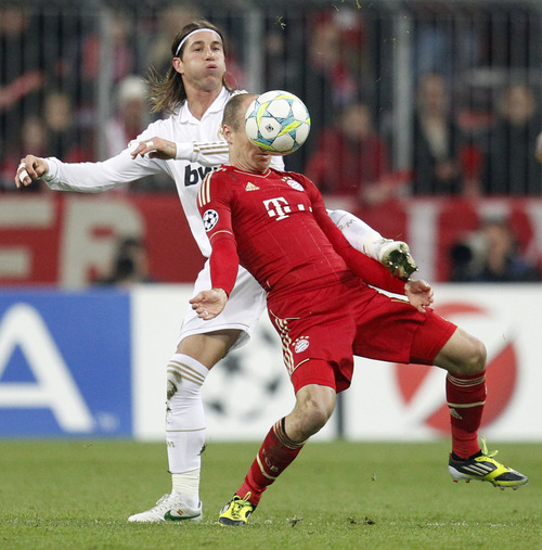 Bayern's Arjen Robben, right, and Madrid's Sergio Ramos challenge for the ball during the Champions League first leg semifinal soccer match between Bayern Munich and Real Madrid in Munich, southern Germany, Tuesday, April 17, 2012. (AP Photo/Matthias Schrader)