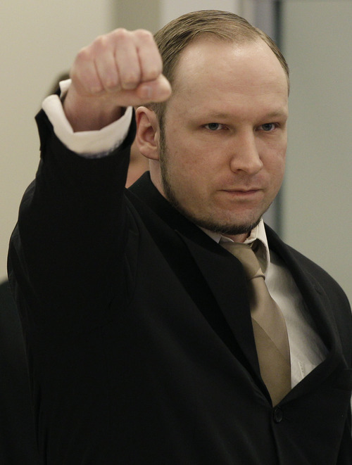 Accused Norwegian Anders Behring Breivik gestures as he arrives at the courtroom, in Oslo, Norway, Tuesday April 17, 2012. The anti-Muslim fanatic who admitted to killing 77 people in a bomb-and-shooting massacre is set to take the stand in his terror trial. Anders Behring Breivik will have five days to explain why he set off a bomb in Oslo's government district, killing eight, and then gunned down 69 at a Labor Party youth camp outside the Norwegian capital. (AP Photo/Frank Augstein)
