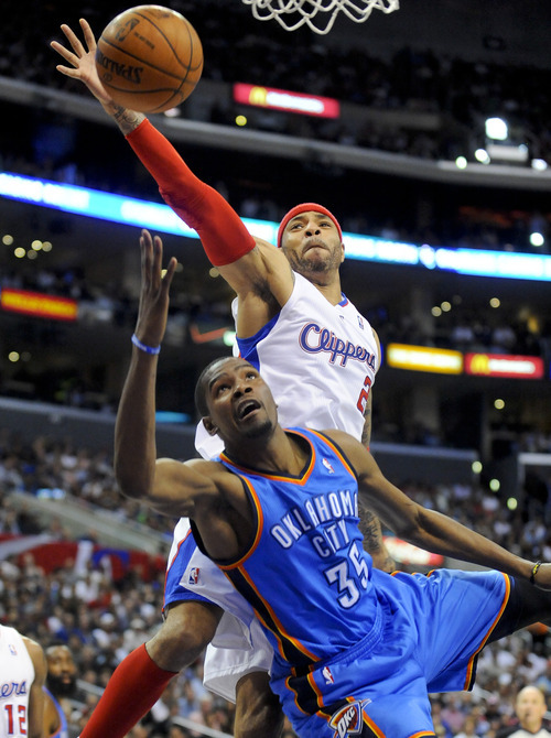Los Angeles Clippers forward Kenyon Martin (2) blocks Oklahoma City Thunder forward Kevin Durant's (35) shot in the second half of an NBA basketball game, Monday, April 16, 2012, in Los Angeles. The Clippers won 92-77. (AP Photo/Gus Ruelas)