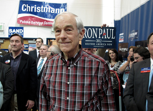 Republican presidential candidate Ron Paul, a GOP congressman from Texas, waits for his turn on the stage during a North Dakota Republican district convention on Monday, Feb. 20, 2012, at the Shiloh Christian School in Bismarck, N.D. (AP Photo/Dale Wetzel)