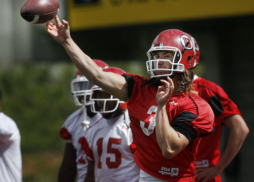 Scott Sommerdorf  |  The Salt Lake Tribune              Utah QB Jordan Wynn throws as The University of Utah football team practices at Rice-Eccles Stadium, Thursday, April 19, 2012.