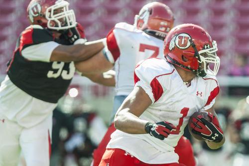Chris Detrick  |  The Salt Lake Tribune Utah Utes defensive back Keith McGill (1) runs the ball during a practice at Rice-Eccles Stadium Tuesday April 17, 2012.