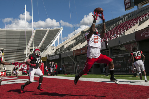 Chris Detrick  |  The Salt Lake Tribune Utah Utes wide receiver Kenneth Scott (2) attempts to make a catch in the end zone during a practice at Rice-Eccles Stadium Tuesday April 17, 2012.