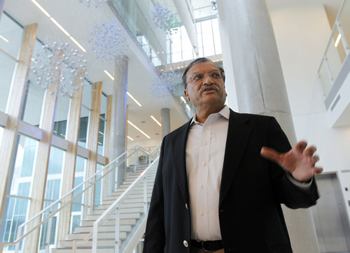 Al Hartmann  |  The Salt Lake Tribune Dinesh Patel, USTAR board chairman, tours the James L. Sorenson Molecular Biotechnology Building, the University of Utah's new $130 million USTAR facility, on Wednesday April 18. The building is being dedicated on Thursday, April 19.
