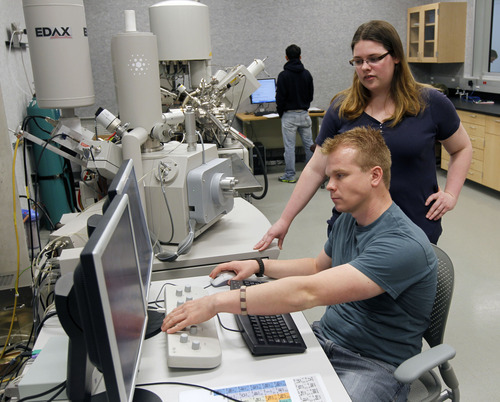 Al Hartmann  |  The Salt Lake Tribune Undergraduate mechanical engineeers Ben Anderson and Sadee Hansen work on an electron microscope in the microscopy suite at the James L. Sorenson Molecular Biotechnology Building.