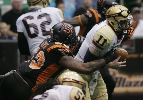 Kim Raff | The Salt Lake Tribune Utah Blaze Defensive lineman Mike Lewis sacks Iowa Barnstormers quarterback J.J. Raterink during a game at the Energy Solutions Arena in Salt Lake City, Utah on April 20, 2012.