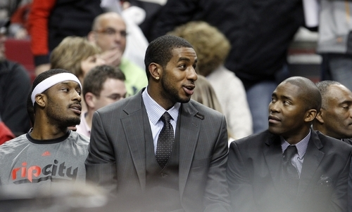 Portland Trail Blazers' LaMarcus Aldridge, center, and Jamal Crawford, right, talk while Craig Smith, left, listens on the bench during the first quarter of an NBA basketball game against the Utah Jazz on Wednesday, April 18, 2012, in Portland, Ore.  (AP Photo/Rick Bowmer)