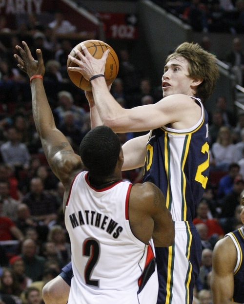Utah Jazz's Gordon Hayward goes up for a shot as Portland Trail Blazers' Wesley Matthews (2) defends during the first quarter of an NBA basketball game Wednesday, April 18, 2012, in Portland, Ore.  (AP Photo/Rick Bowmer)