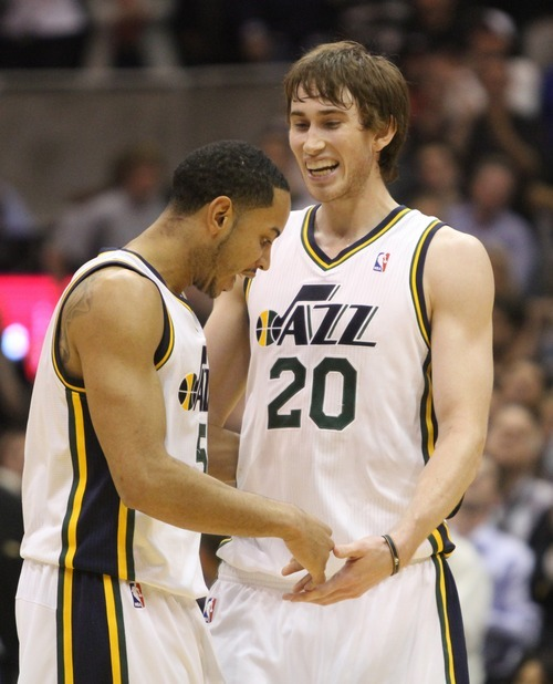 Rick Egan  | The Salt Lake Tribune   Devin Harris (5) and Gordon Hayward (20) celebrate as the Jazz go up 100-96 over the Mavericks in a game at the EnergySolutions Arena, Monday, April 16, 2012.