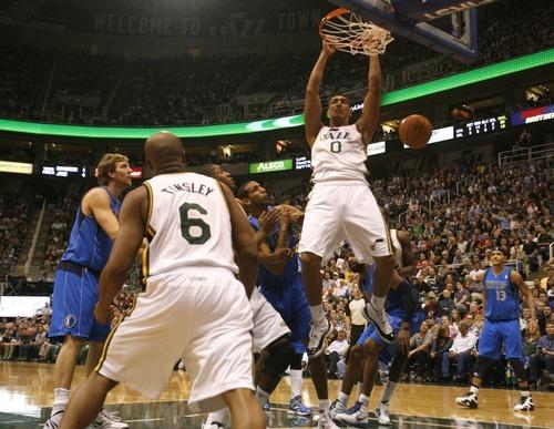 Rick Egan  | The Salt Lake Tribune   Utah Jazz forward Enes Kanter dunks the ball against the Dallas Mavericks at  EnergySolutions Arena, Monday, April 16, 2012.