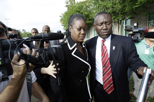 Sybrina Fulton, left, mother of Trayvon Martin and attorney Benjamin Crump, arrive at the Seminole County Criminal Justice Center for a bond hearing for George Zimmerman, the neighborhood watch volunteer charged with murdering Trayvon Martin, Friday, April 20, 2012, in Sanford, Fla.  Zimmerman's attorney is asking the Seminole County judge to let Zimmerman post bail at the hearing Friday.(AP Photo/John Raoux)