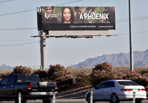 Matt York  |  AP file photo A University of Phoenix billboard is shown in Chandler, Ariz.  Two senators say for-profit colleges are using too much taxpayer money to recruit students. Sen. Tom Harkin, D-Iowa, and Sn. Kay Hagan, D-N.C., introduced a bill Wednesday to prohibit colleges of all kinds from using dollars from federal student assistance programs to pay for advertising.