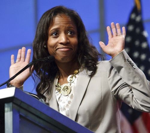 Leah Hogsten     The Salt Lake Tribune Saratoga Springs Mayor Mia Love captured the 4th Congressional District Republican nomination by knocking out former Rep. Carl Wimmer in a second round of balloting Saturday at the party's nomination convention.