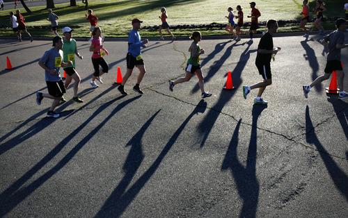 Scott Sommerdorf  |  The Salt Lake Tribune              Runners run the loop through Sugarhouse Park near the four-mile mark during the Salt Lake Marathon, Saturday, April 21, 2012.