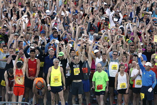 Runners stretch as they wait for the final few minutes to elapse at the start of the Salt Lake City Marathon, Saturday, April 21, 2012 at the Legacy Bridge near the University of Utah.  (AP Photo/The Salt Lake Tribune, Scott Sommerdorf)