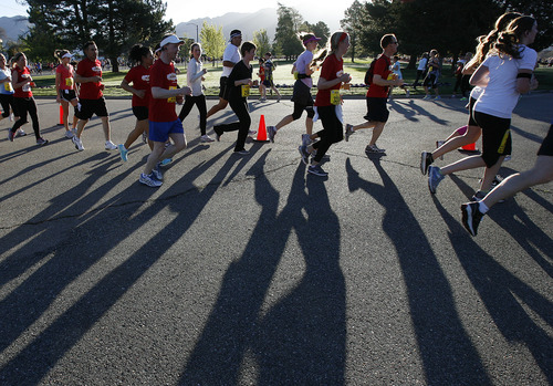Runners in the half-marathon enter Sugarhouse Park at about the four-mile mark in the Salt Lake City Marathon, Saturday, April 21, 2012.  (AP Photo/The Salt Lake Tribune, Scott Sommerdorf)