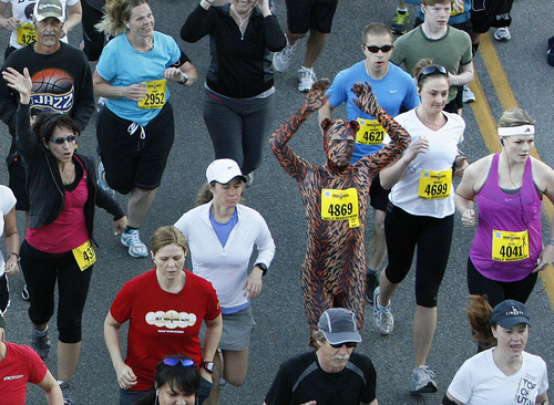 Morgan Doane of Draper, in a cat suit, starts the Salt Lake City Marathon, Saturday, April 21, 2012.   (AP Photo/The Salt Lake Tribune, Scott Sommerdorf)