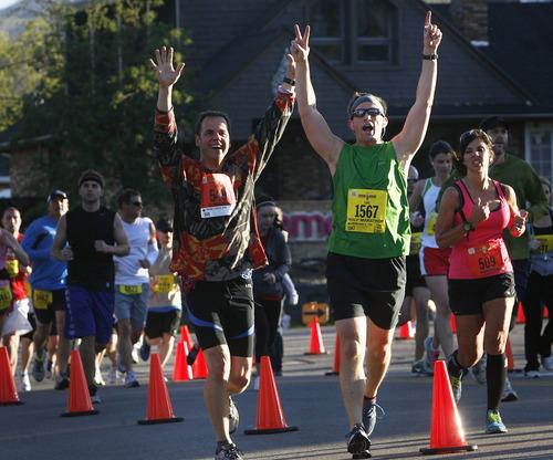 Jubilant runners in the half-marathon as they enter Sugarhouse Park at about the four-mile mark of the Salt Lake Marathon, Saturday, April 21, 2012.   (AP Photo/The Salt Lake Tribune, Scott Sommerdorf)