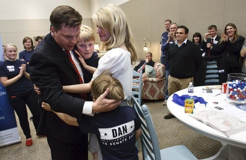 Leah Hogsten  |  The Salt Lake Tribune Former state Sen. Dan Liljenquist hugs his wife Brooke and sons Nate, 7, and Ben, 4, after learning that he and Sen. Orrin Hatch will face a primary election. Hatch came up just short of the support needed to claim his party's nomination for the seventh time, forcing him into a primary in June. After two rounds of balloting, Hatch had the support of 59.1 percent, a handful of votes short of the 60 percent threshold to claim the nomination outright.The Utah Republican Party held its nominating convention Saturday, April 21 2012 in Sandy at the South Towne Exposition Center.