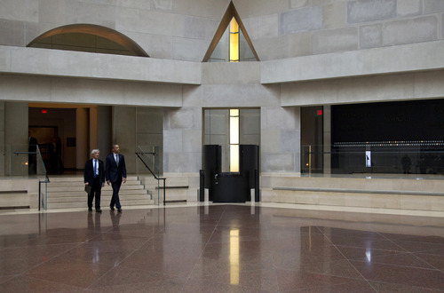 President Barack Obama and Nobel Peace Prize laureate and Holocaust survivor Elie Wiesel enter the Hall of Remembrance as they tour the Holocaust Memorial Museum in Washington, Monday, April 23, 2012. (AP Photo/Carolyn Kaster)