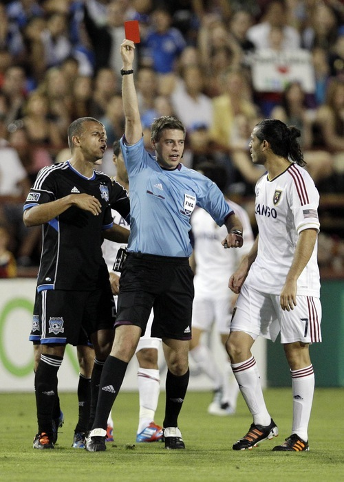 Real Salt Lake forward Fabian Espindola, right, is red-carded and ejected from the game after a rough tackle as San Jose Earthquakes' Jason Hernandez (21), left, looks on during the second half of a MLS soccer game in San Jose,  Saturday, April 21, 2012. (AP Photo/Marcio Jose Sanchez)