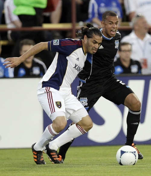 Real Salt Lake forward Fabian Espindola, left, is defended by San Jose Earthquakes' Jason Hernandez (21), during the first half of a MLS soccer game in San Jose,  Saturday, April 21, 2012. (AP Photo/Marcio Jose Sanchez)