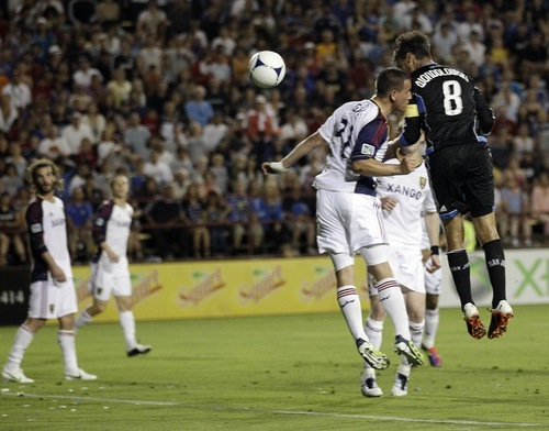 San Jose Earthquakes's Chris Wondolowski (8) scores on a header past Real Salt Lake's Luis Gil during the second half of a MLS soccer game in San Jose,  Saturday, April 21, 2012. (AP Photo/Marcio Jose Sanchez)