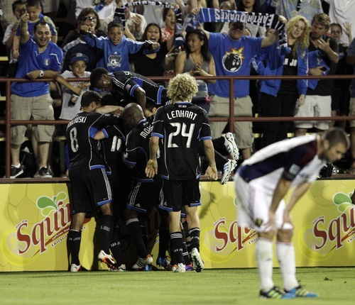 The San Jose Earthquakes celebrate a goal by Simon Dawkins against Real Salt Lake during the second half of a MLS soccer game in San Jose,  Saturday, April 21, 2012. (AP Photo/Marcio Jose Sanchez)