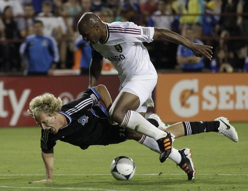 San Jose Earthquakes's Steven Lenhart (24) is fouled by Real Salt Lake's Jamison Olave (4) during the second half of a MLS soccer game in San Jose,  Saturday, April 21, 2012. Olave was red-carded and ejected after the foul.  (AP Photo/Marcio Jose Sanchez)