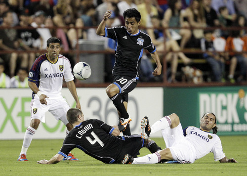 San Jose Earthquakes'  Rafael Baca (30) leaps over Real Salt Lake's Fabian Espindola (7), right, and teammate Sam Cronin (4) during the first half of a MLS soccer game in San Jose,  Saturday, April 21, 2012. (AP Photo/Marcio Jose Sanchez)