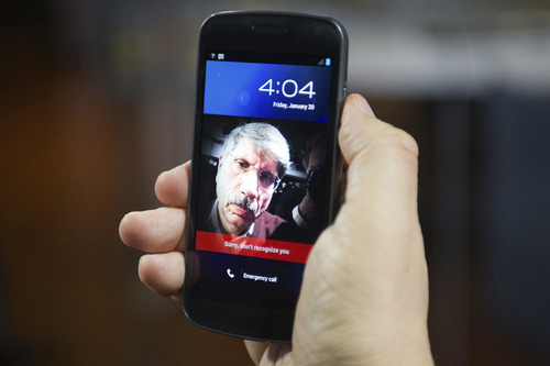 The Samsung Galaxy Nexus phone is displayed in San Francisco, California, U.S., on Friday, Jan. 20, 2012. In this example, the Face Unlock application, which should allow a user to unlock their phone, does not recognize Bloomberg technology columnist Rich Jaroslovsky. The Galaxy Nexus, which costs $299 on a two-year contract from Verizon Wireless, is the first device to ship with Android 4.0. Photographer: David Paul Morris/Bloomberg *** Local Caption *** Rich Jaroslovsky