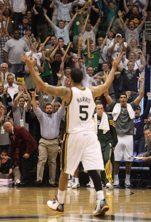 Rick Egan  | The Salt Lake Tribune   Utah Jazz point guard Devin Harris (5) celebrates with Jazz fans after his 3-point shot put the Jazz up115-107, in overtime in NBA action, Utah Jazz vs. The Orlando Magic, in Salt Lake City,  Saturday, April 21, 2012