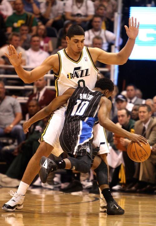 Rick Egan  | The Salt Lake Tribune   Ishmael Smith slams into Utah Jazz forward Enes Kanter (0),  in NBA action, Utah Jazz vs. The Orlando Magic, in Salt Lake City,  Saturday, April 21, 2012
