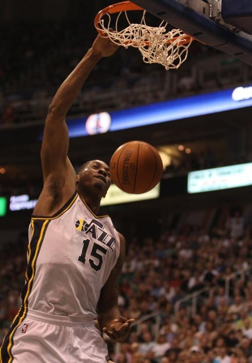Rick Egan  | The Salt Lake Tribune   Utah Jazz power forward Derrick Favors (15) gets a slam dunk, in NBA action, Utah Jazz vs. The Orlando Magic, in Salt Lake City,  Saturday, April 21, 2012