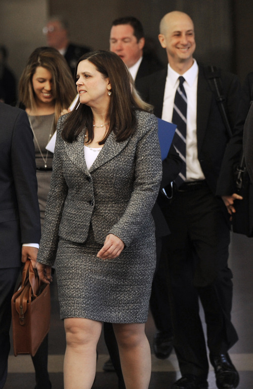 William Balfour's defense attorney Amy Thompson, along with his defense team, walks to court at the Cook County Criminal Court on the first day of the trial of Balfour,  in Chicago, Monday, April 23, 2012. Balfour is charged in the 2008 murder of Oscar winning actress and singer Jennifer Hudson's mother, brother and nephew. (AP Photo/Paul Beaty)