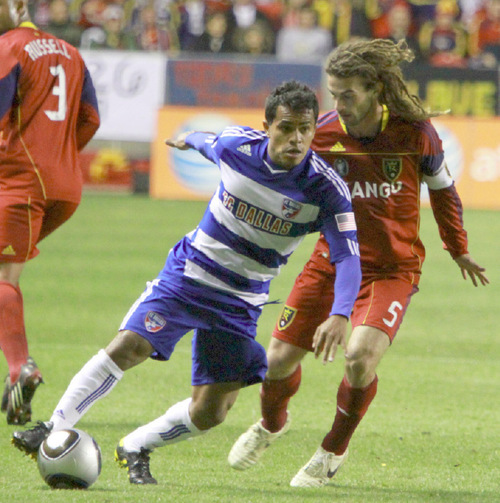 FC Dallas midfielder David Ferreira breaks past Real Salt Lake midfielder Kyle Beckerman in the first half in Rio Tinto Stadium. Stephen Holt / Special to the Tribune