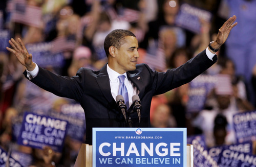 FILE - In this June 3, 2008 file photo, then-Democratic presidential candidate, Sen. Barack Obama, D-Ill., waves to supporters before speaking at a primary night rally in St. Paul, Minn. Barack Obama and Mitt Romney are in the cat-and-mouse stage of their national race, chasing each other around the map as they jockey for position. (AP Photo/Morry Gash, File)